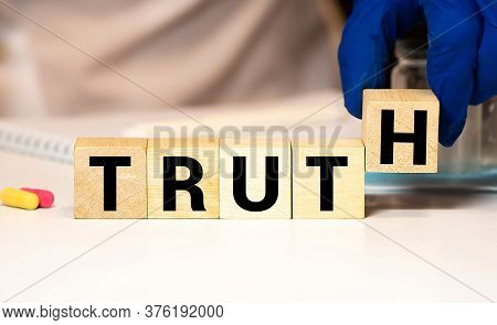 Truth - Word From Wooden Blocks With Letters, Real Facts Truth Concept, Random Letters Around, White