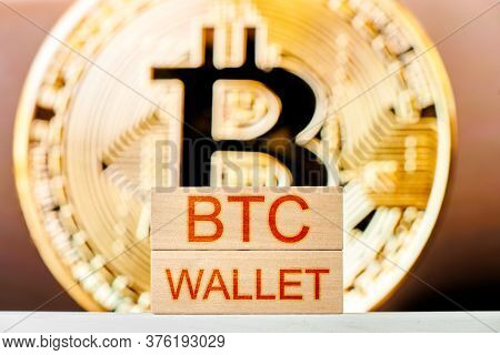 Btc Wallet Concept. Wooden Blocks With The Inscription Btc Wallet With Bitcoin On The Background