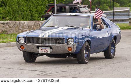 Fairhaven, Massachusetts, Usa - July 4, 2020: Amc Amx Muscle Car Passing Fort Phoenix During Fairhav