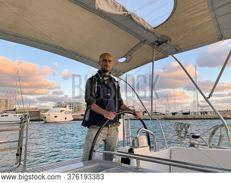 Skipper Takes The Yacht Out Of The Marina