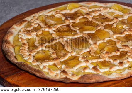 Sweet Pizza With Banana, Sweet Sigh And Cinnamon. Traditional Brazilian Sweet Pizza With Banana And