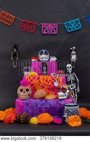 Traditional Mexican Day Of The Dead Offering Altar With Cut Paper, Skeletons, Skulls, Bread, Chocola