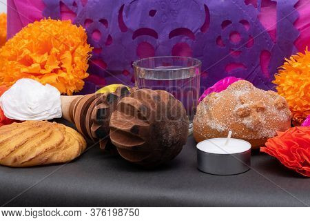 Part Of A Mexican Day Of The Dead Offering Altar With A Chocolate Grinder, Flowers, Bread, Candles A