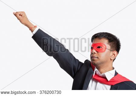 Asian businessman pretending to be a superhero against white background