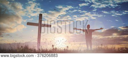 Happy Man Rise Hand Worship God In Morning View. Christian Spirit Prayer Praise On Good Friday Cross