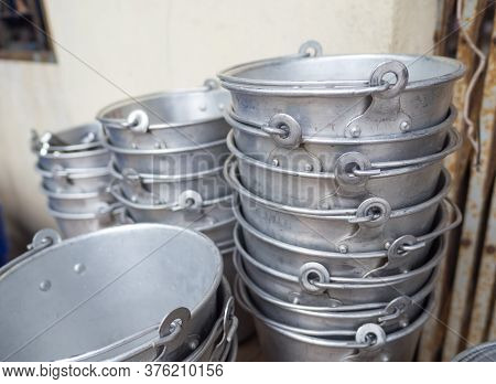 Many Old Aluminum Ice Bucket Laid In Wait For Use.