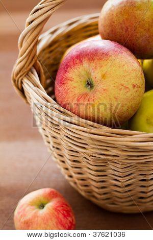 Ripe apples in a basket