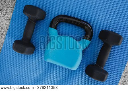 Healthy And Fit Lifestyle Concept, Home Gym Equipment On Yoga Mat Including Dumbbells And Kettlebell