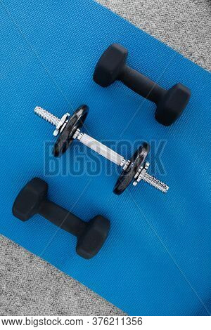 Healthy And Fit Lifestyle Concept, Home Gym Equipment On Yoga Mat Including Dumbbells And Weights