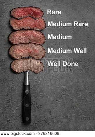 Delicious Sliced Beef Tenderloins With Different Degrees Of Doneness On Grey Background, Top View