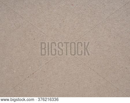 Light Brown Cardboard Sheet Background Or Wallpaper. Cellulose Fiber. Close-up