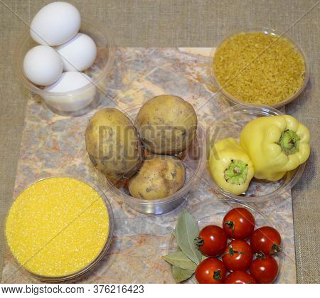 Ingredients For Cooking Fast Food Dishes: Eggs, Potatoes, Bulgur, Cherry Tomatoes, Bay Leaf, Corn Gr