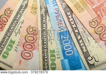 Cash Banknotes Background. The Background Of The American And Russian Money Banknotes. Dollars And R