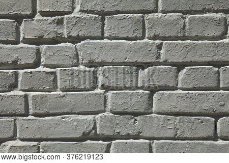 Dim Brick Wall Texture, Background In White Color. The Building Wall, Painted With Whitewased Water-