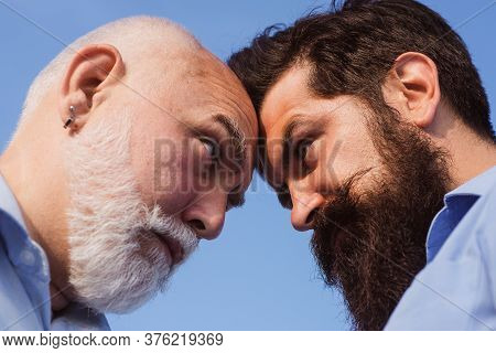 Man Looking At Each Other - Close Up Portrait. Man In Different Ages. Man Vs Concept. Old Father And