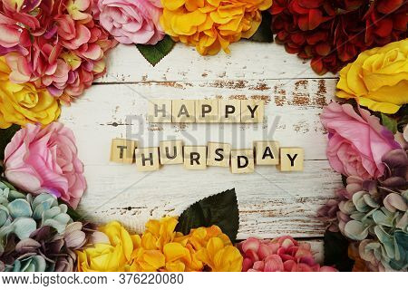 Happy Thursday Alphabet Letter With Colorful Flowers Border Frame On Wooden Background