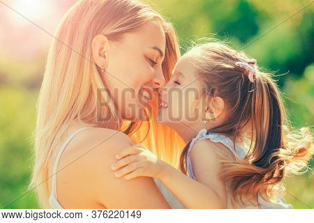Portrait Of Happy Mother And Daughter. Close Up Smiling Faces Of Mom And Child. Happy Smiling Mother
