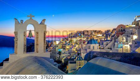 Romantic evening night panorama of Santorini island, Greece. Picturesque night on the famous Greek resort Oia, Greece, Europe.