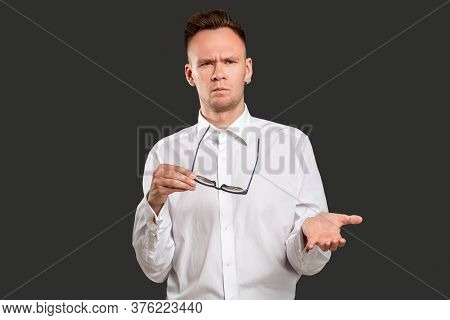 Overwhelmed Man Portrait. Wtf Gesture. Disturbed Confused Shocked Guy With Eyeglasses Questioning Ra