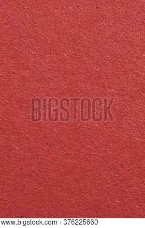 The Surface Of Dark Red Cardboard. Rough Paper Texture With Cellulose Fibers. Saturated Color. Verti