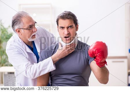 Young injured boxer visiting old doctor traumatologist