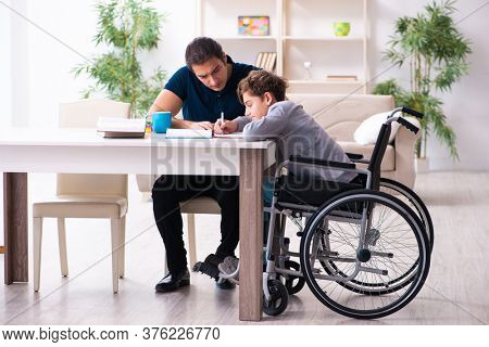 Father and disabled son in education concept