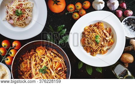 Italian Food, Pasta Bolognese, Tomatoes Sauce, And Carbonara With Fresh Ingredient