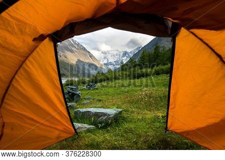 View And Turisticheskoi Tents On The Lake Ak-kem And The Top Of Belukha In The Altay