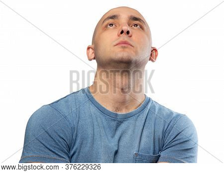 Photo Of Bald Puzzled Man In Tee Shirt