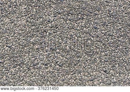 Grunge Asphalt Structure Texture. Closeup Granular Noise Background. Street Grain Pattern.