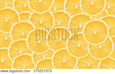 Orange Slices Background. Orange Fruit Cut Texture. Citrus Section Pattern. Vibrant Color Vitamin C