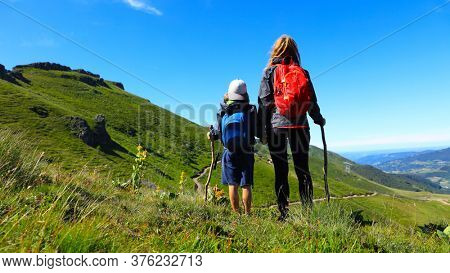 hiking trail, family with backpack- Plomb du Cantal, Auvergne-Cantal