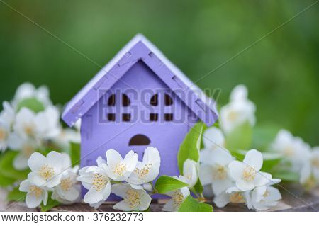 Fabulous, Toy House And Jasmine Flowers On A Natural Green Background, A Concept Of  Summer Mood, Ha