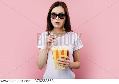Girl In 3d Glasses With Popcorn Watching Fascinating Movie