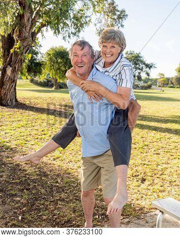 Happy Senior Couple In Love Having Fun In The Park