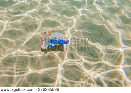 Creative Background, Plastic Bag Floating In The Ocean, A Bag In The Water. The Concept Of Environme