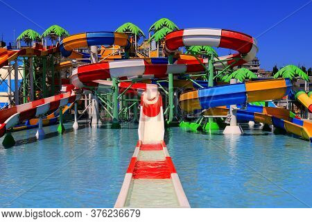 Dnipro, Ukraine, 26 06 2020. Colorful Roller Coasters In The Picturesque Water Park. Resort In Sprin