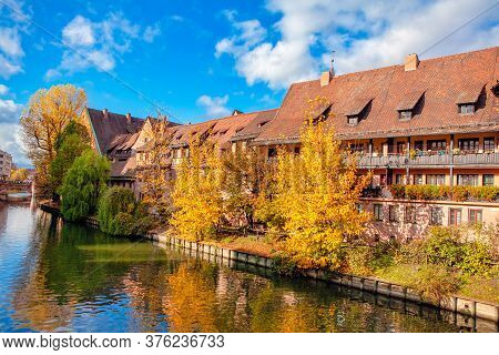 Residential District Situated At The Riverside . Autumn Scenery In German City . House With Attics S