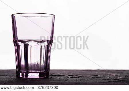Faceted Glass Cup On A White Background. Clean Glassware Container.