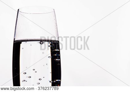 Close Up Alco Cocktail With Bubbles Isolated On White. Champagne Glass Cup.
