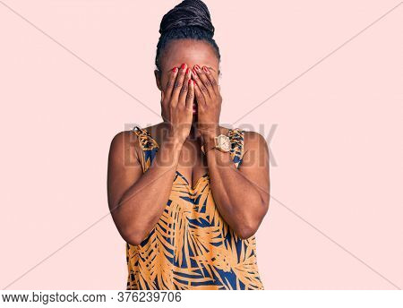 Young african american woman wearing casual clothes rubbing eyes for fatigue and headache, sleepy and tired expression. vision problem