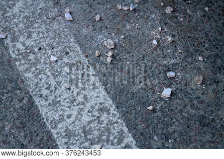 Close-up Asphalt Road With White Edge Line. Grainy Road Surface.