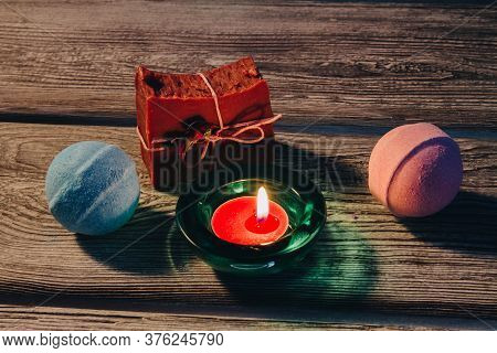 Spa Concept With Bath Bombs, Handmade Soap And Burning Candle Onwooden Background. Blue, Strawberry