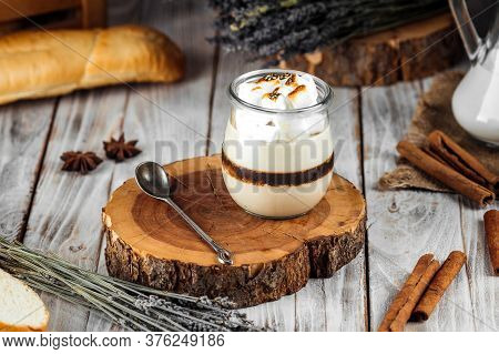 Puff Layer Dessert In A Jar With Cream And Toasted Marshmallows, Horizontal