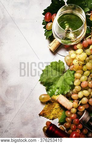 Dry White Wine From Chardonnay Grapes, Gray Stone Background, Top View, Selective Focus