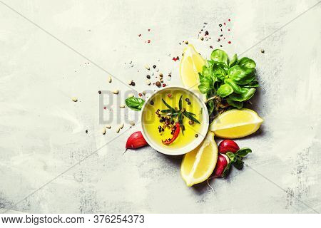 Salad Dressing With Basil, Olive Oil, Garlic, Lemon And Spices, Top View, Food Background