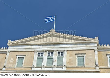 Athens, Greece, June 04, 2016. Greek National Flag On Top Of The Greek Parliament Building.