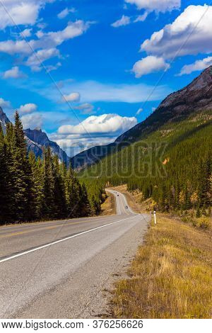 The mountain valley of Provincial Park. Lush autumn in the Canadian Rockies. Kananaskis highway in Rocky Mountain. The concept of active, ecological and photo tourism