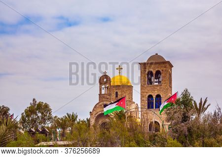 Jordan River. Qasr el-Yahud - the place of baptism of Jesus Christ by John the Baptist. Church of John the Baptist. The river runs the border between Israel and Jordan. T