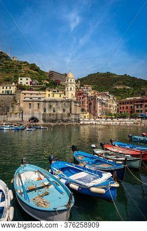 Ancient Village Of Vernazza With The Boats In The Harbor. Cinque Terre, National Park In Liguria, La